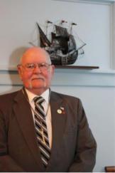 George E Becker